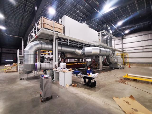 Machine servant à la production du Meltblown
